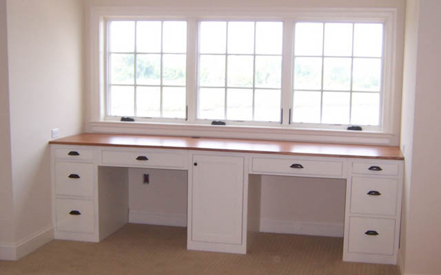 Custom cabinets for your home office entertainment area for Built in study table