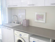 Renovate your laundry with new cupboards and benchtops