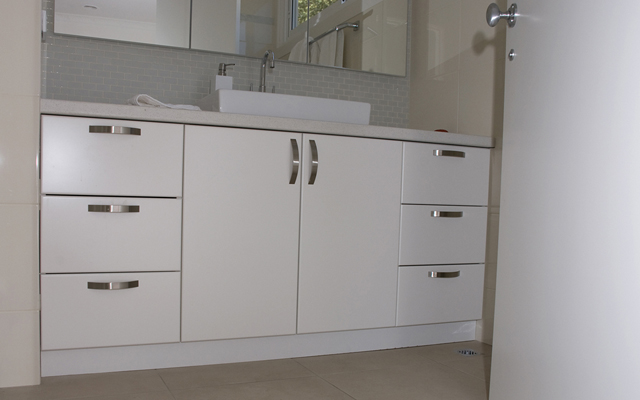 decor and functionalty of your bathrooms with new vanities and shelves